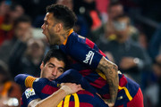 Luis Suarez (L) of FC Barcelona celebrates with his teammates Lionel Messi (C) and Dani Alves (top) after scoring his team's first goal during the Copa del Rey Quarter Final Second Leg between FC Barcelona and Athletic Club at Camp Nou stadium on January 27, 2016 in Barcelona, Spain.