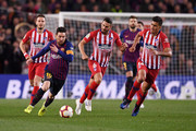 Lionel Messi of Barcelona is chased by Rodri and Koke of Atletico Madrid during the La Liga match between FC Barcelona and  Club Atletico de Madrid at Camp Nou on April 06, 2019 in Barcelona, Spain.