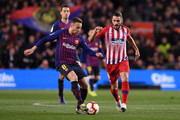 Arthur of Barcelona takes on Koke of Atletico Madrid during the La Liga match between FC Barcelona and  Club Atletico de Madrid at Camp Nou on April 06, 2019 in Barcelona, Spain.