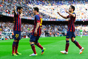 Lionel Messi (C) of FC Barcelona celebrates with his team-mates Dani Alves (L) and Xavi Hernandez after scoring the opening goal during the La Liga match between FC Barcelona and Getafe CF at Nou Camp on May 3, 2014 in Barcelona, Spain.