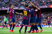 Dani Alves (L), Rafinha (R) and Lionel Messi (CL) celebrate after their teammate Luis Suarez (CR) scored his team's second goal during the La Liga match between FC Barcelona and Getafe CF at Camp Nou on April 28, 2015 in Barcelona, Spain.