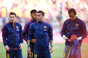 (L-R) Lionel Messi, Neymar, Dani Alves and Claudio Bravo of FC Barcelona look on during the La Liga match between FC Barcelona and Granada CF at Camp Nou on September 27, 2014 in Barcelona, Spain.