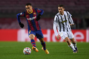 Sergino Dest of Barcelona controls the ball away from Aaron Ramsey of Juventus F.C. during the UEFA Champions League Group G stage match between FC Barcelona and Juventus at Camp Nou on December 08, 2020 in Barcelona, Spain. Sporting stadiums around Spain remain under strict restrictions due to the Coronavirus Pandemic as Government social distancing laws prohibit fans inside venues resulting in games being played behind closed doors.