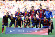 (Back row L-R) Adriano Correia, Javier Mascherano, Sergio Busquets, Gerard Pique, Victor Valdes (Front row L-R) Lionel Messi, Dani Alves, Alexis Sanchez, Pedro Rodriguez with his son, Cesc Fabregas and Xavi Hernandez prior to the La Liga match between FC Barcelona and Levante UD on August 18, 2013 in Barcelona, Spain.