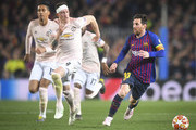 Lionel Messi of Barcelona in action with Chris Smalling and Phil Jones of Manchester United during the UEFA Champions League Quarter Final second leg match between FC Barcelona and Manchester United at Camp Nou on April 16, 2019 in Barcelona, Spain.