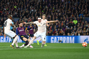 Lionel Messi of Barcelona scores his team's second goal as Phil Jones of Manchester United tries to challenge  during the UEFA Champions League Quarter Final second leg match between FC Barcelona and Manchester United at Camp Nou on April 16, 2019 in Barcelona, Spain.