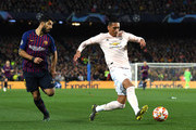 Chris Smalling of Manchester United stretches for the ball as Luis Suarez of Barcelona puts him under pressure during the UEFA Champions League Quarter Final second leg match between FC Barcelona and Manchester United at Camp Nou on April 16, 2019 in Barcelona, Spain.