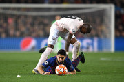 Luis Suarez of Barcelona is fouled by Ashley Young of Manchester United during the UEFA Champions League Quarter Final second leg match between FC Barcelona and Manchester United at Camp Nou on April 16, 2019 in Barcelona, Spain.