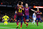 Alexis Sanchez of FC Barcelona celebrates with his team-mate Neymar of FC Barcelona after scoring the opening goal during the La Liga match between FC Barcelona and RCD Espanyol at Camp Nou on November 1, 2013 in Barcelona, Spain.