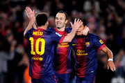 Lionel Messi of Barcelona celebrates with teammates Andres Iniesta (C) and Alexis Sanchez (R) after scoring his team's fourth goal during the La Liga match between FC Barcelona and Real Betis Balompie at Camp Nou on May 5, 2013 in Barcelona, Spain.