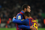 Alexis Sanchez (R) of FC Barcelona celebrates scoring his sides third goal with his teammate Daniel Alves during the la Liga match between FC Barcelona and Real Betis Balompie at the Camp Nou stadium on January 15, 2012 in Barcelona, Spain.