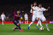 Luis Suarez of Barcelona shoots past Sergio Ramos and Pepe of Real Madrid CF to score their second goal during the La Liga match between FC Barcelona and Real Madrid CF at Camp Nou on March 22, 2015 in Barcelona, Spain.