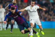 Lionel Messi of FC Barcelona is brought down by Lucas Vazquez of Real Madrid CF during the Copa del Semi Final first leg match between Barcelona and Real Madrid at Nou Camp on February 06, 2019 in Barcelona, Spain.