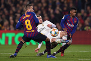 Gareth Bale of Real Madrid CF misses a chance to score under a challenge by Arthur Melo (L) and Nelso Semedo of FC Barcelona during the Copa del Semi Final first leg match between Barcelona and Real Madrid at Nou Camp on February 06, 2019 in Barcelona, Spain.