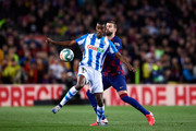 Alexander Isak of Real Sociedad controls the ball under pressure from Gerard Pique of FC Barcelona during the Liga match between FC Barcelona and Real Sociedad at Camp Nou on March 07, 2020 in Barcelona, Spain.