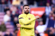 Gerard Pique of FC Barcelona warms up prior to the Liga match between FC Barcelona and Real Sociedad at Camp Nou on March 07, 2020 in Barcelona, Spain.