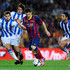 Lionel Messi Photos - Lionel Messi of FC Barcelona duels for the ball among Real Sociedad de Futbol players during the La Liga match between FC Barcelona and Real Sociedad de Futbol at Camp Nou on September 24, 2013 in Barcelona, Spain. - Lionel Messi Photos - 9178 of 13396
