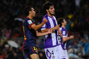 Pedro Rodriguez of FC Barcelona (L) celebrates after scoring the opening goal  past Marc Valiente of Real Valladolid CF during the La Liga match between FC Barcelona and Real Valladolid CF at Camp Nou on May 19, 2013 in Barcelona, Spain.
