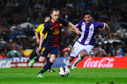 Andres Iniesta of FC Barcelona duels for the ball with Marc Valiente of Real Valladolid CF during the La Liga match between FC Barcelona and Real Valladolid CF at Camp Nou on May 19, 2013 in Barcelona, Spain.
