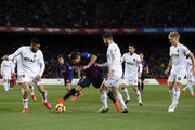Luis Suarez of Barcelona is challenged by Ezequiel Garay and Cristiano Piccini of Valencia during the La Liga match between FC Barcelona and Valencia CF at Camp Nou on February 2, 2019 in Barcelona, Spain.