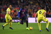 Ousmane Dembele of Barcelona takes on Santi Cazorla (L) and Victor Ruiz of Villareal (R) during the La Liga match between FC Barcelona and Villarreal CF at Camp Nou on December 2, 2018 in Barcelona, Spain.