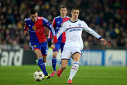 Fernando Torres of Chelsea is challenged by Taulant Xhaka of Basel during the UEFA Champions League Group E match between FC Basel 1893 and Chelsea at St. Jakob-Park on November 26, 2013 in Basel, Switzerland.