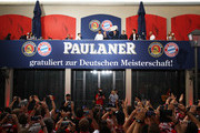 Thomas Mueller of FC Bayern Muenchen celebrates winning the Bundesliga with fans in the beer garden at the Paulaner am Nockherberg on May 12, 2018 in Munich, Germany.