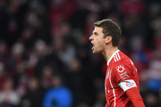 Bayern Munich's striker Thomas Mueller reacts after the first goal during the German first division Bundesliga football match between FC Bayern Munich and FC Cologne on December 13, 2017 in Munich. / AFP PHOTO / Christof STACHE / RESTRICTIONS: DURING MATCH TIME: DFL RULES TO LIMIT THE ONLINE USAGE TO 15 PICTURES PER MATCH AND FORBID IMAGE SEQUENCES TO SIMULATE VIDEO. == RESTRICTED TO EDITORIAL USE == FOR FURTHER QUERIES PLEASE CONTACT DFL DIRECTLY AT + 49 69 650050.
