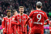 Robert Lewandowski #9 of Bayern Munich celebrates with Thomas Mueller and his team-mates after scoring his team's first to make it 1-0 during the Bundesliga match between FC Bayern Muenchen and 1. FC Koeln at Allianz Arena on December 13, 2017 in Munich, Germany.