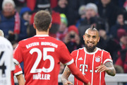 Arturo Vidal of Bayern Muenchen (r) celebrates with Thomas Mueller of Bayern Muenchen after he scored a goal to make it 1:0 during the Bundesliga match between FC Bayern Muenchen and Hannover 96 at Allianz Arena on December 2, 2017 in Munich, Germany.