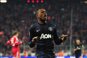 Patrice Evra of Manchester United celebrates his goal during the UEFA Champions League Quarter Final second leg match between FC Bayern Muenchen and Manchester United at Allianz Arena on April 9, 2014 in Munich, Germany.
