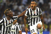 Arturo Vidal (R) of Juventus FC celebrates his goal with team-mate Paul Pogba (L) during the Serie A match between FC Internazionale Milano and Juventus FC at San Siro Stadium on September 14, 2013 in Milan, Italy.