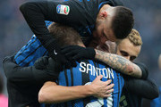 Ivan Perisic of FC Internazionale Milano (C) celebrates his first goal with his team-mate Mauro Emanuel Icardi, Davide Santon and Marcelo Brozovic during the Serie A match between FC Internazionale and AC Chievo Verona at Stadio Giuseppe Meazza on December 3, 2017 in Milan, Italy.