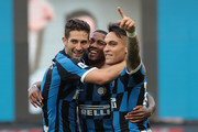 Ashley Young (C)  of FC Internazionale celebrates his goal with his team-mate Lautaro Martinez (R) and Roberto Gagliardini (L) during the Serie A match between FC Internazionale and Brescia Calcio at Stadio Giuseppe Meazza on July 1, 2020 in Milan, Italy.