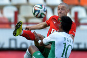 Maksim Grigoryev (L) of FC Lokomotiv Moscow is challenged by Kanu of FC Terek Grozny during the Russian Premier League match between FC Lokomotiv Moscow and FC Terek Grozny at Lokomotiv Stadium on April 19, 2014 in Moscow, Russia.