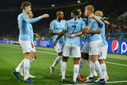 David Silva of Manchester City celebrates with teammates after scoring his team's first goal during the Group F match of the UEFA Champions League between FC Shakhtar Donetsk and Manchester City at Metalist Stadium on October 23, 2018 in Kharkov, Ukraine.