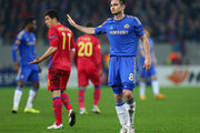 Frank Lampard of Chelsea apologises to a team mate during the UEFA Europa League Round of 16 match between FC Steaua Bucuresti and Chelsea at the National Arena on March 7, 2013 in Bucharest, Romania.