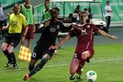 Kanu of FC Terek Grozny challenges Ivan Marcano (R) of FC Rubin Kazan for the ball during the Russian Premier League match between FC Terek Grozny and FC Rubin Kazan at the Akhmad-Arena Stadium on July 28, 2013 in Grozny, Russia.