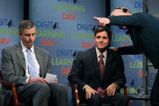 Education Secretary Arne Duncan (L), and FCC Chairman Julius Genachowski (R), prepare to participate in a town hall meeting for the first national Digital Learning Day, at the Newseum on February 1, 2012 in Washington, DC. Digital Learning Day is a nationwide celebration of innovative teaching and learning using digital media and technology.