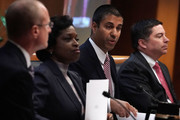 Federal Communications Commission Chairman Ajit Pai speaks as commission members (L-R) Brendan Carr, Mignon Clyburn, Michael O'Rielly listen during a commission meeting December 14, 2017 in Washington, DC. FCC has voted to repeal its net neutrality rules at the meeting.