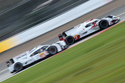 Cars Audi Sport Team Joest (R) driven by Marcel Fassler of Switzerland, Andre Lotterer of Germany and Benoit Treluyer of France battle in the final few laps with Porsche Team (L) driven by Romain Dumes of France, Neel Jani of Switzerland and Marc Lieb of Germany during the FIA World Endurance Championship 6 Hours of Silverstone race at Silverstone on April 12, 2015 in Northampton, England.