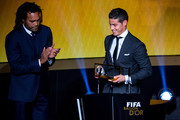 James Rodriguez of Colombia and Real Madrid (R) receives the FIFA Puskas Award from Christian Karembeu of France during the FIFA Ballon d'Or Gala 2014 at the Kongresshaus on January 12, 2015 in Zurich, Switzerland.