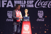 FIFA honorary ambassador Christian Karembeu carries the FIFA World Cup Trophy during the event of presentation as part of the FIFA World Cup Trophy that has now arrived to South Korea at Westin Chosun Hotel on April 4, 2014 in Seoul, South Korea.
