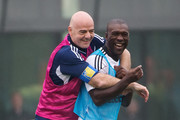 FIFA President Gianni Infantino (L) jokes with Clarence Seedorf (R) during a FIFA Team Friendly Football Match at the FIFA headquarters on February 29, 2016 in Zurich, Switzerland.