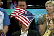 President of the United States, George W. Bush waves the American Flag next to wife Laura Bush while attending the swimming finals at the National Aquatics Center during day 2 of the Beijing 2008 Olympic Games on August 10, 2008 in Beijing, China.