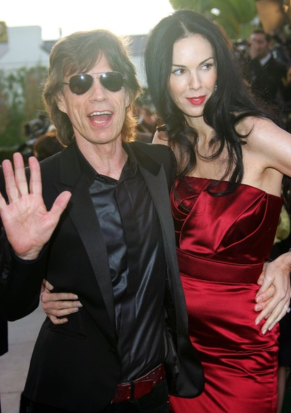 Singer Mick Jagger and his girlfriend L'Wren Scott arrive at the Vanity Fair Oscar Party at Mortons on March 5, 2006 in West Hollywood, California.