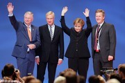 German Chancellor Angela Merkel (2nd R) waves to the delegates after her speech with (L- R), Roland Koch, Governor of Hesse, Ole von Beust, Lord Mayor of Hamburg, and Christian Wulff, Governor of Lower Saxony, during the 21st party congress of the German Christian Democratic Party (CDU) on December 3, 2007 in Hanover, Germany. The party plans to agree on a new basic policy program to last for the upcoming 10 to 15 years.