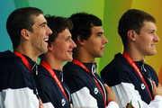 (L-R) Michael Phelps, Ryan Lochte, Ricky Berens and Peter Vanderkaay of the United States pose with the gold medal on the podium during the medal ceremony for the Men's 4 x 200m Freestyle Relay Final at the National Aquatics Centre during Day 5 of the Beijing 2008 Olympic Games on August 13, 2008 in Beijing, China.  The United States won the race in a time of 6:58.56, a new World Record.