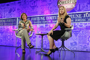 Pattie Sellers and Chelsea Clinton speak onstage at the FORTUNE Most Powerful Women Summit on October 17, 2013 in Washington, DC.