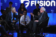 Journalist Jorge Ramos and democratic presidential Bernie Sanders (R) pictured onstage during the FUSION presents the Brown & Black Democratic Forum at Drake University on January 11, 2016 in Des Moines, Iowa.